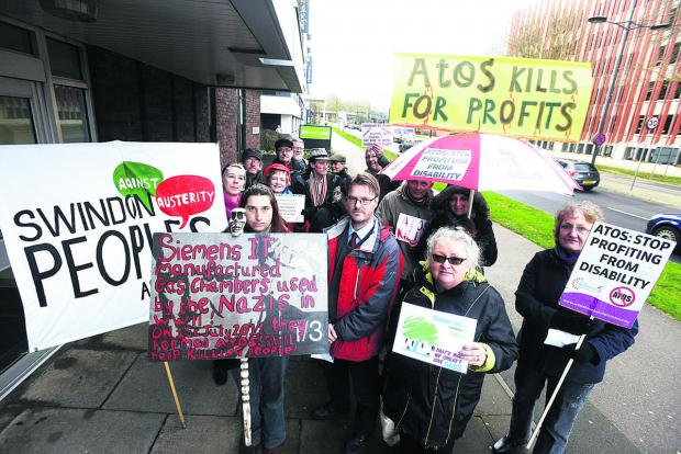 This Is Wiltshire: Protesters outside the Job Centre in Princes Street
