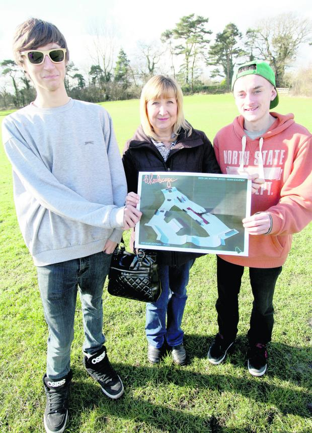 This Is Wiltshire: Chris Huzzey, Sue Huzzey and Aaron Marlow look at the plans for the Green Lane site