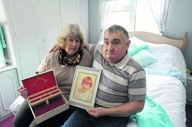 This Is Wiltshire: Anne and Paul Sinfield, who returned from holiday to find mementoes of their daughter stolen  (DV1122)