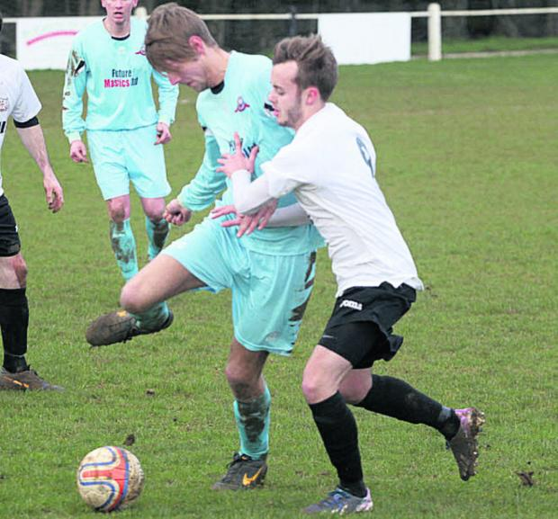 This Is Wiltshire: Calne Town's Jamie Jordan (white) challenges Kieran Marsden during the Lilywhites' 6-0 win over Portishead Town on Saturday