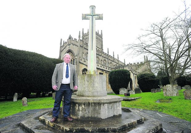 This Is Wiltshire: Coun Alan Hill at the war memorial in St Mary's Church, Calne