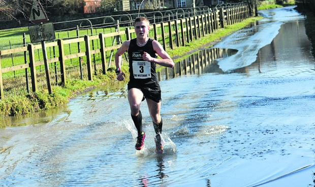 This Is Wiltshire: Winner Simon Nott splashes his way through Reybridge