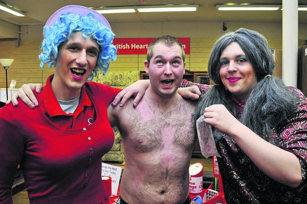 This Is Wiltshire: Trowbridge's British Heart Foundation shop manager James Chilton loses his chest hair for  charity with the help of colleagues Dean Hulbert, left, and Mike Clark