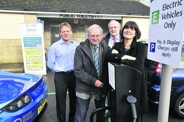 This Is Wiltshire: Shay Parsons of Climate Friendly Bradford on Avon with, from left, Kevin Sharpe of Zero Carbon World, Cllr Horace Prickett and Cllr Richard Gamble at the car charging point in Bradford station car park 	Photo: Glenn Phillips (49157)