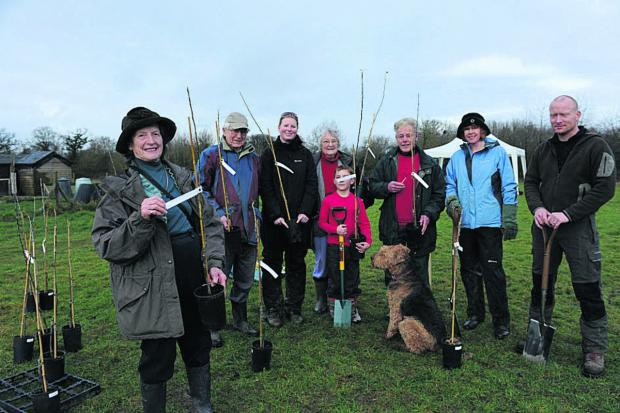 This Is Wiltshire: Mary Hember, left, council staff and Friends of Southwick Country park           (48356-1)