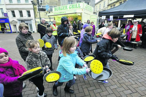 This Is Wiltshire: A children's pancake race gets under way last year