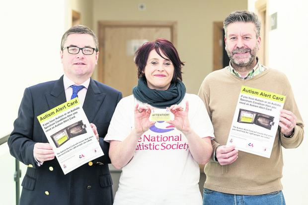 This Is Wiltshire: Launching the new Austism Alert Card to help those with austism avoid trouble are, from left, South Swindon MP