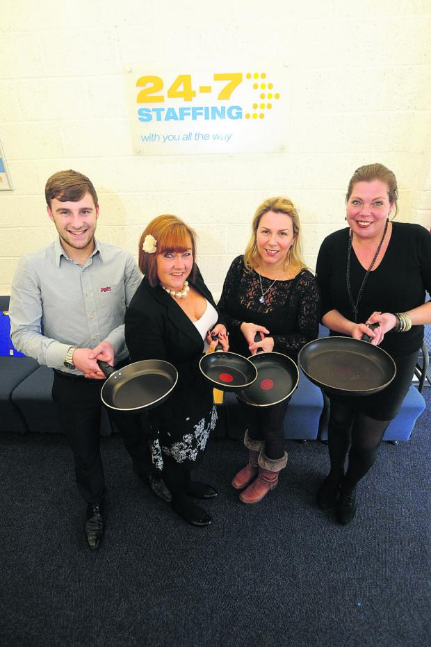 This Is Wiltshire: Staff from 24/7 Staffing, from left, Joshua Thompson, Lisa Waters, Melody Thompson and Jo Ball gear up for the pancake race