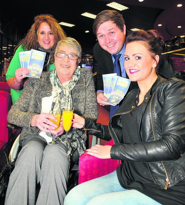 This Is Wiltshire: Yvonne Woolf having her Christmas Wish granted at Gala Bingo in Greenbridge, with her granddaughters Kimberley Newbold and Danielle Bird, and Steve Rogers of Gala Bingo