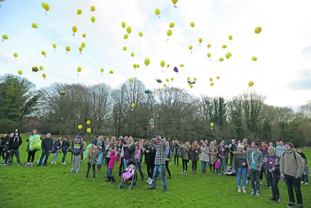 This Is Wiltshire: Family and friends of Ashley McKinnon released yellow balloons in his memory in Moredon