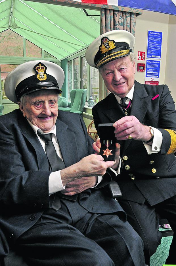 This Is Wiltshire: Reginald Smart being awarded the Arctic Star by Rear-Admiral Nick Wilkinson