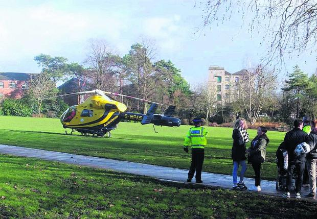 This Is Wiltshire: The air ambulance arrives. Picture by Mike Prior