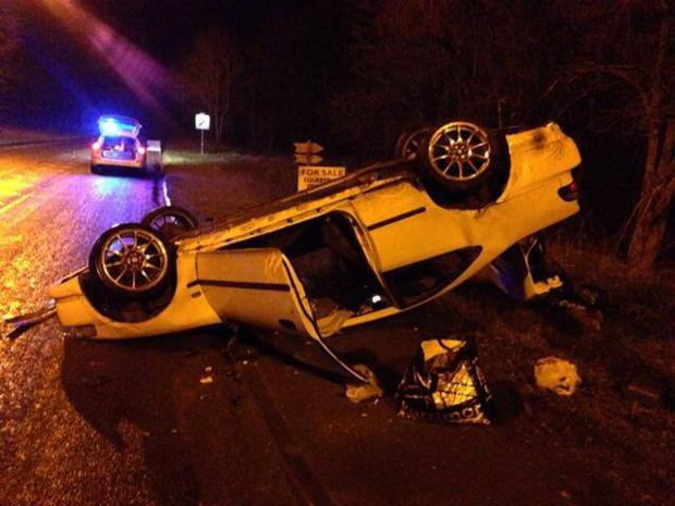 This Is Wiltshire: An overturned car in Bassett at the weekend (picture: Royal Wootton Bassett & Cricklade Police)