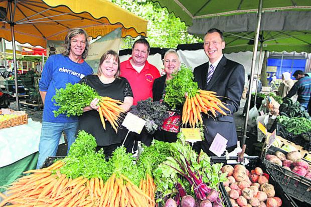 This Is Wiltshire: Kardien Gerbrands, Coun Emma Faramarzi, Duncan Paget from DS Paget & Co vegetables, In Swindon bid manager Rebecca Rowland and In Swindon chairman Paul Booth at the launch of the market