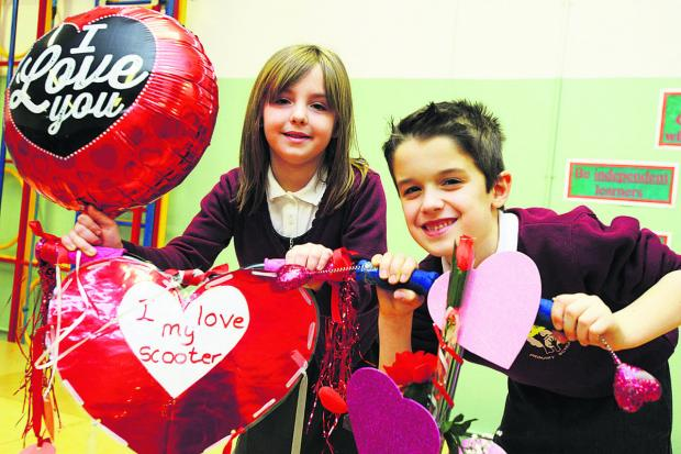This Is Wiltshire: Two Covingham Park school pupils with their decorated bikes. Picture: THOMAS KELSEY