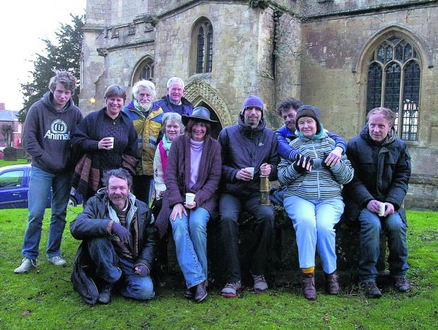 This Is Wiltshire: Opendoor chairman Eddie Sims, front centre, and friends mark the end of their successful sleepout