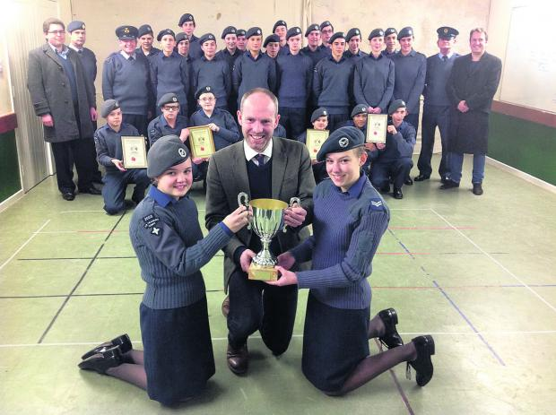 This Is Wiltshire: Stratton Air Cadets receive their poppy sales award from MP for North Swindon, Justin Tomlinson