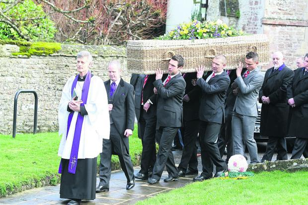 This Is Wiltshire: Pallbearers carry the coffin of Dave Turner at Wroughton Parish Church yesterday