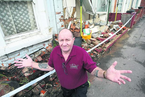 This Is Wiltshire: Graham Swatton pictured outside his home in Curtis Street, where a Range Rover crashed into his and his neighbour's houses last year