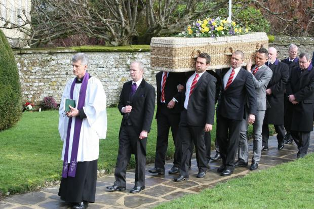This Is Wiltshire: Pallbearers carry the coffin of Dave Turner into Wroughton Parish Church yesterday