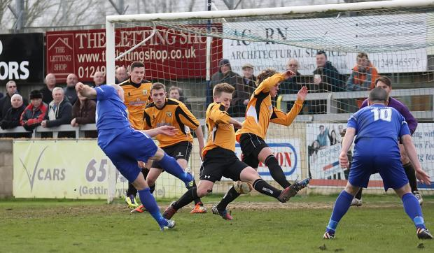 This Is Wiltshire: Chippenham Town striker Alan Griffin shoots during his side's 2-0 win over Bashley on Saturday (Picture by Robin Foster)