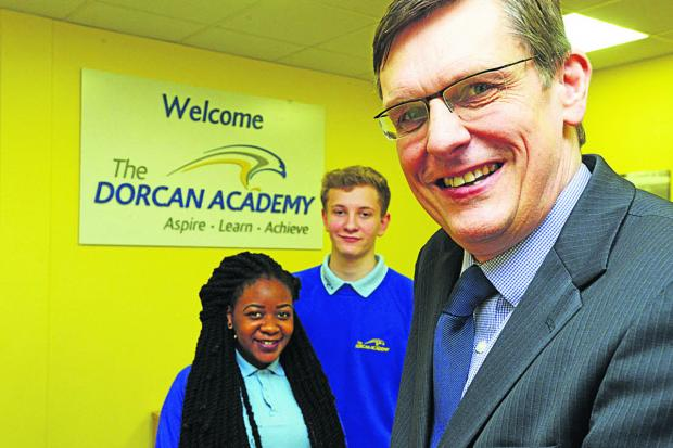 This Is Wiltshire: Dorcan Academy has improved after advice set out by Ofsted. Pictured is head Dr Scott Sissons and head girl and boy Jospeh Killick and Tatenda Moyo