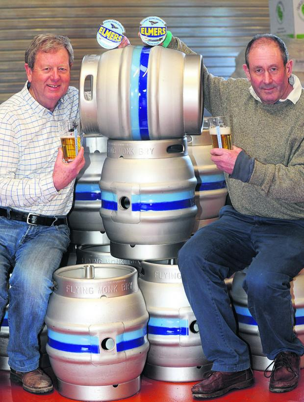 This Is Wiltshire: Iain Morrison and Tony Kemp with barrels of ale ready for launch day