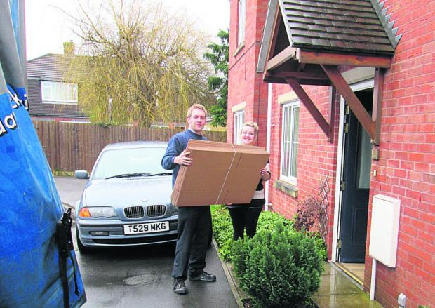 This Is Wiltshire: Matt Rose helps deliver the boxes from D S Smith to Laura Self at her home in Trowbridge