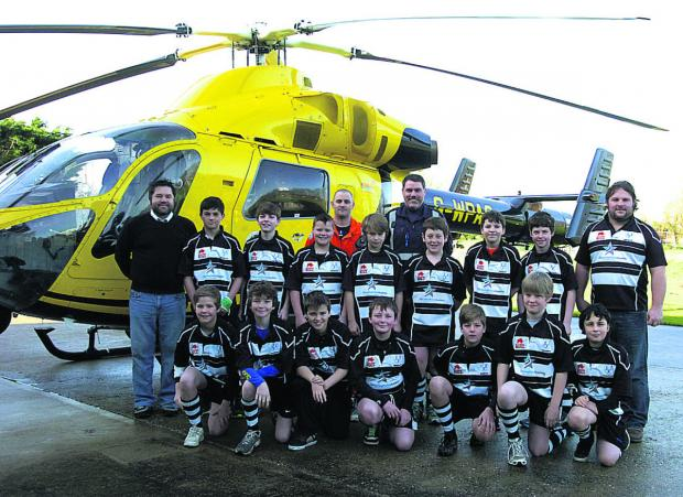 This Is Wiltshire: The fundraising Chippenham under-12s rugby team with, back row, coach Dean Alkin, Matt Baskerville, Nigel Gilbert, coach James Harding and the Air Ambulance