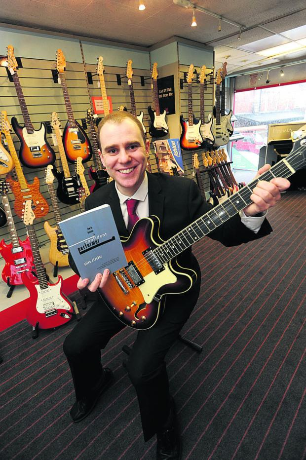 This Is Wiltshire: Music teacher Clive Stoker tunes up at Noteworthy Music in Chippenham