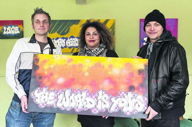This Is Wiltshire: With one of the pieces of art, from left, Young Carers group leader Matt Teale, youth offending officer Cathy Hill and local artist Colin Astin. Picture: ALEX SKENNERTON
