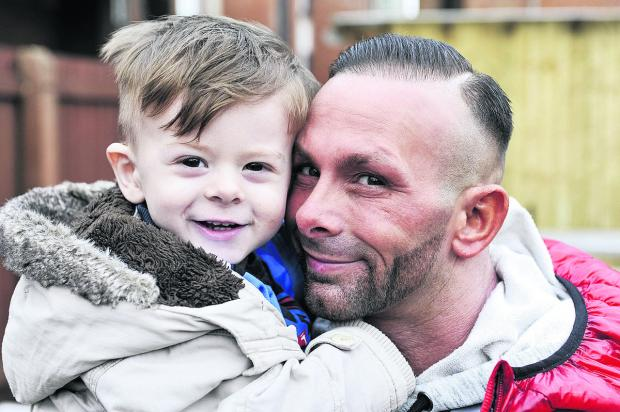 This Is Wiltshire: Sebastian Murtough, who is going to Great Ormond Street Hospital, with his father Steve Murtough