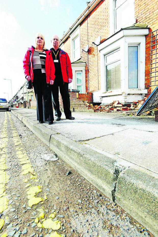 This Is Wiltshire: Coun Bob Wright and Julie Wright, in Curtis Street where the accident happened. The faded road markings are to be renewed