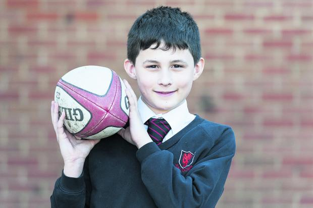 This Is Wiltshire: Kingsdown School pupil Jake Lovelock who will wear his custom-made shirt at the England v Wales Six Nations game at Twickenham