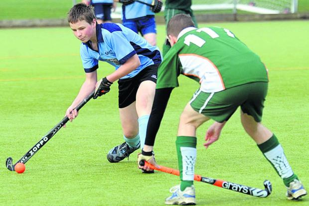 This Is Wiltshire: Chippenham C's Ben Law (blue) take on an opponent during his side's 3-1 defeat to West Wilts E in East Central Two on Saturday