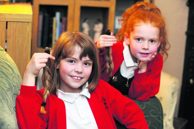 This Is Wiltshire: Lydia Crawford, nine, and six-year-old sister Georgia with her shorn locks and and, left, before they were chopped off in aid of the Little Princess Trust              (DV1137) BY DIANE vose