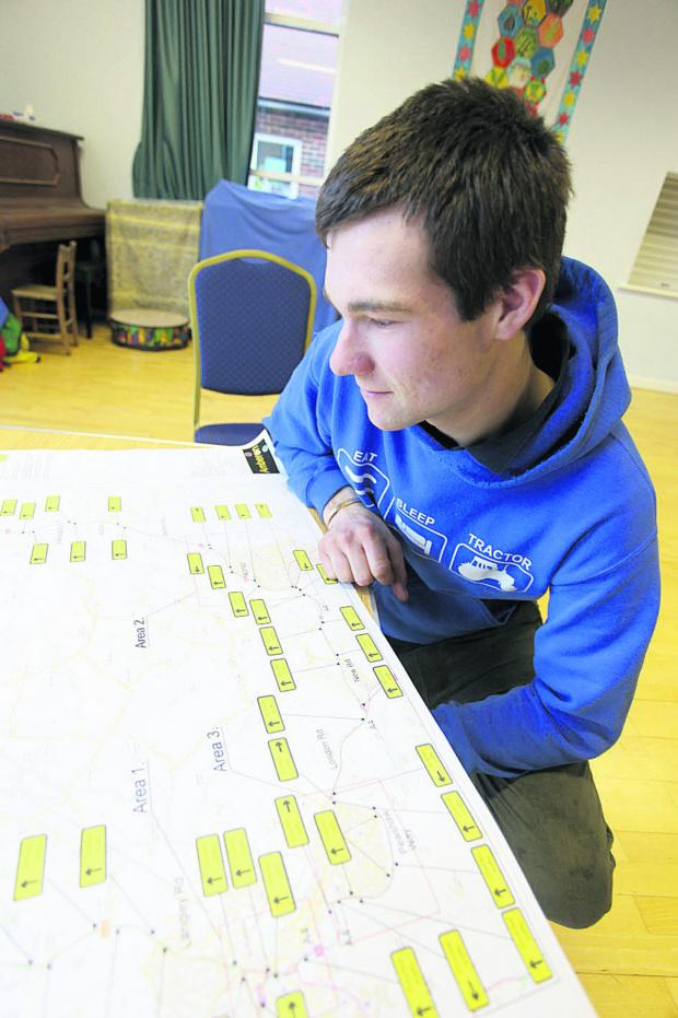 This Is Wiltshire: A visitor to Network Rail's drop-in session for residents of Dauntsey examines plans which detail the work and the temporary closure of the B4069 over the railway at Dauntsey Lock