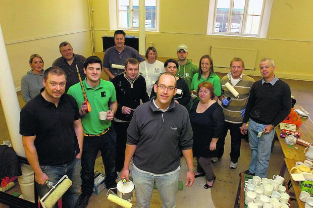 This Is Wiltshire: Centre co-ordinator Ken Neale from GreenSquare with volunteers redecorating the room