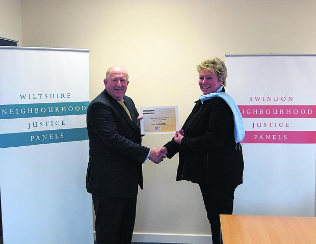 This Is Wiltshire: Landlady Helen Curtis receives her certificate from Police and Crime Commissioner Angus Macpherson
