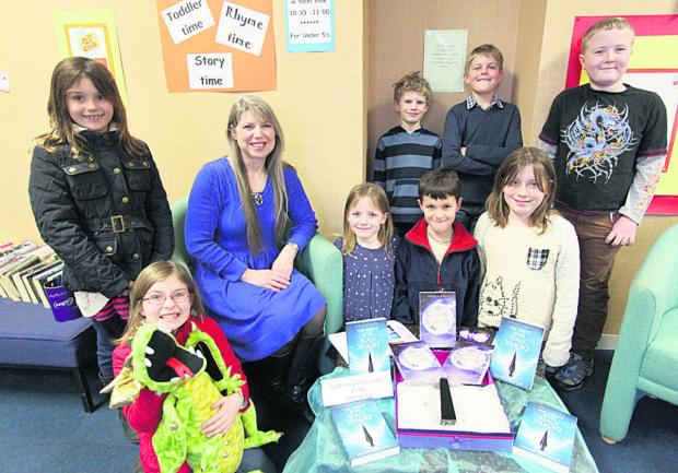 This Is Wiltshire: Children gather for Angela James' visit to the library with her book The Theft of the Black Diamond