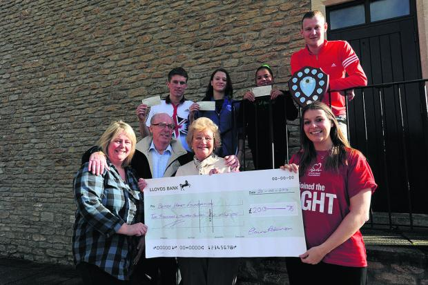 This Is Wiltshire: Elaine Robinson, left,  and Mark's parents Cynthia and Ian Robinson with, l-r, pole vaulter Andy Sutcliffe, Katie James representing Chippenham Park FC, gymnast Larissa Royal, golfer Danny Griffiths and Alison Rosier, of the BHF; inset, Mark Robinson