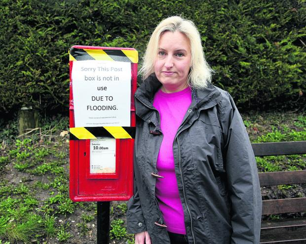 This Is Wiltshire: Kate Digman with the postbox in Lottage Road