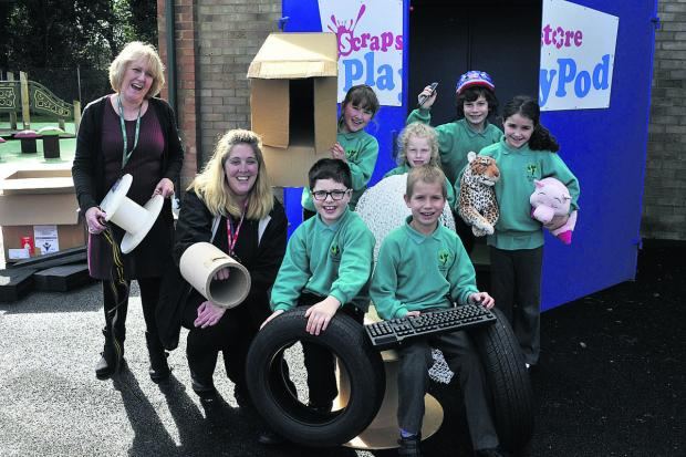 This Is Wiltshire: A PlayPod provides fun at St John's Primary School, Warminster. Pupils Jamie, Dominik, Leah, Shanah, Georgia and Hugo are pictured with headteacher Lyn Taylor, left, and Kate Jackson from the Scrapstore