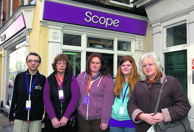 This Is Wiltshire: Volunteer Chris Porter, manager Karen Carr and volunteers Chloe Sims, Karrieanne Sherman and Rozanne Tuck outside the Scope shop that was broken into