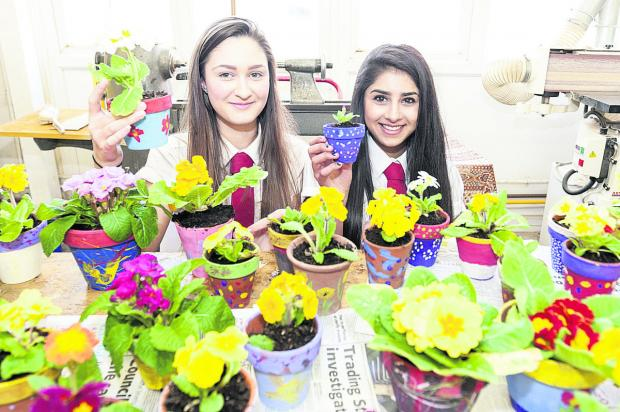 This Is Wiltshire: Kingsdown School pupils Summer Viveash, left, and  Lena Arranch with their plant pots