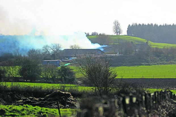 This Is Wiltshire: Smoke rises from the barn at Old Park Farm. Picture: THOMAS KELSEY