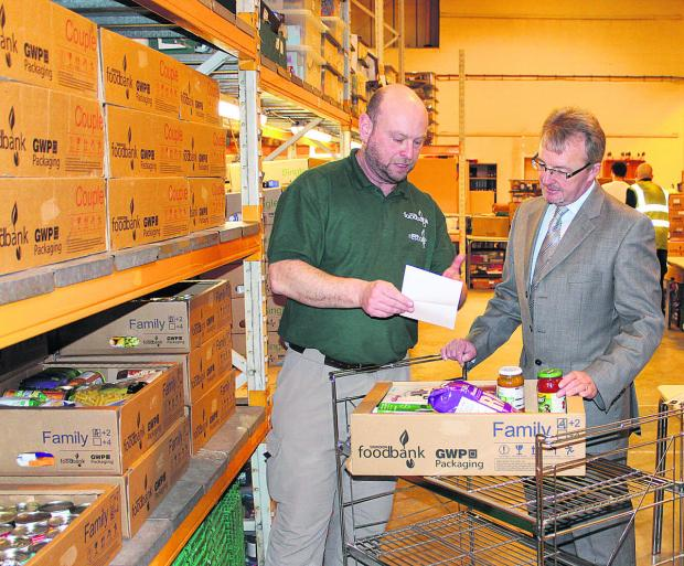 This Is Wiltshire: Andrew Hill, of Swindon Foodbank, and David Pedley, of GWP Group, at the foodbank warehouse