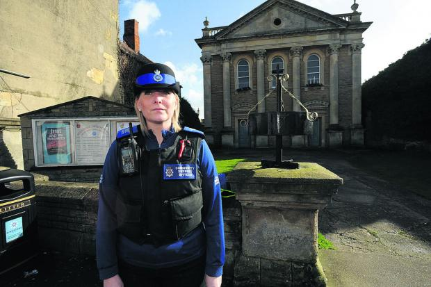 This Is Wiltshire: PCSO Helen Wilson outside Melksham United Church. An 86-year-old woman was mugged shortly after attending a service there