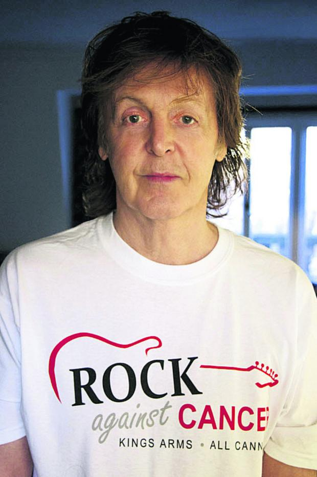 This Is Wiltshire: Sir Paul McCartney wears his Rock Against Cancer T-shirt in support of the All Cannings event