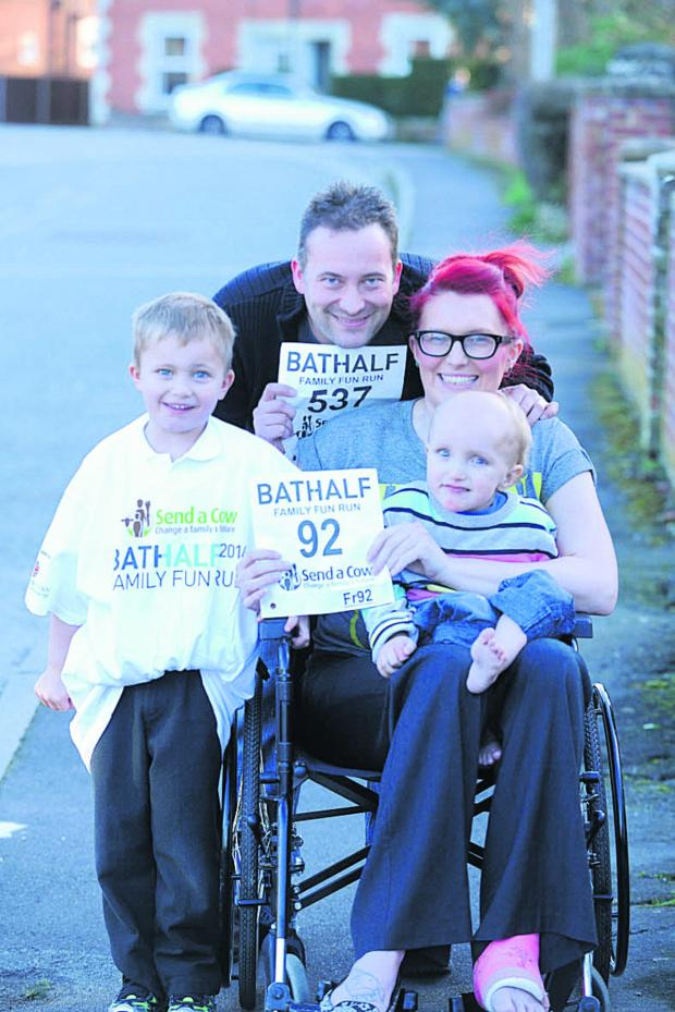 This Is Wiltshire: Lisa Mead-Smith with husband Damien and sons Oscar and Bailey